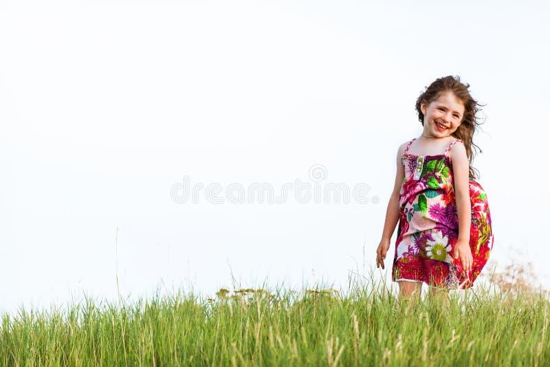 一件五颜六色的礼服的女孩 库存图片
