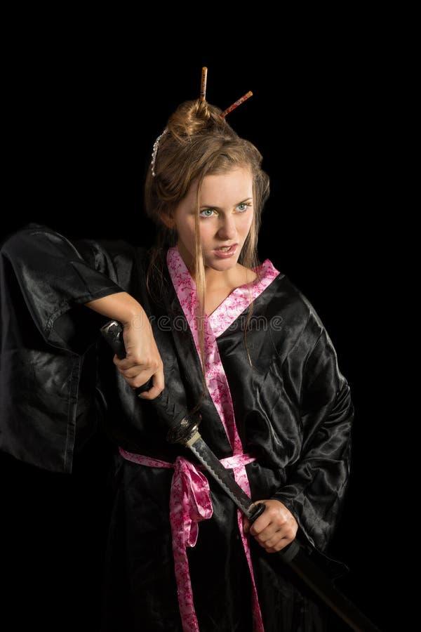 一件和服的女孩有katana的 图库摄影