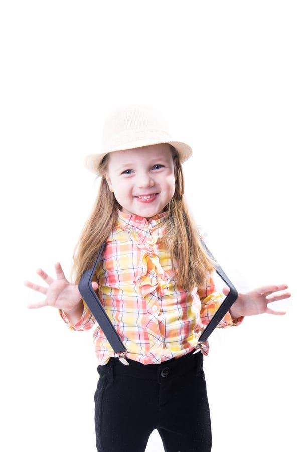 一件夏天帽子格子花呢披肩女衬衫和长裤的女孩有悬挂装置的 库存图片