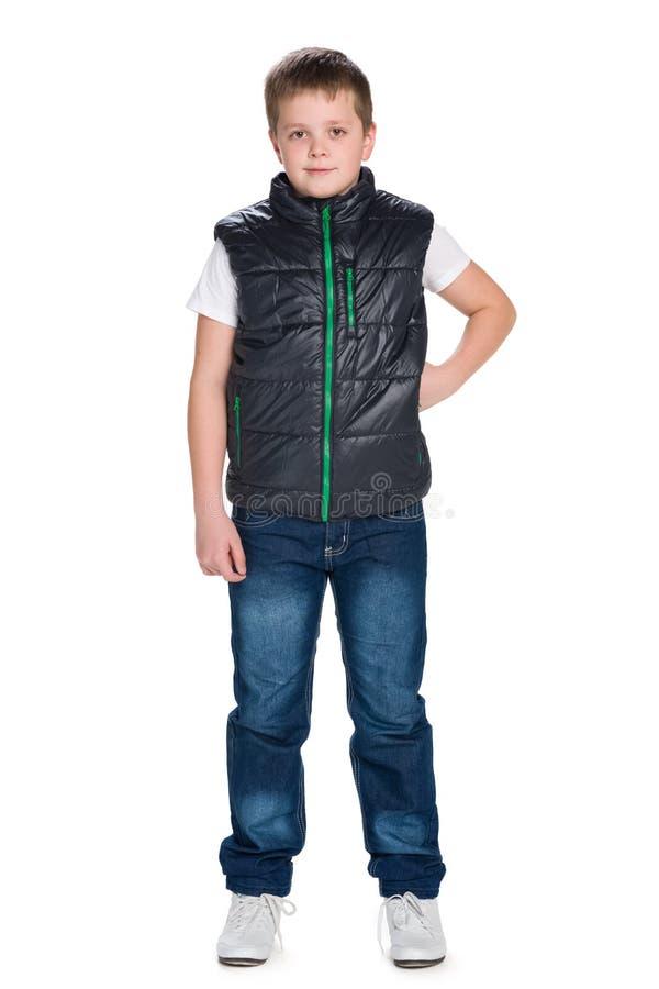 一件夹克的年轻男孩反对白色 免版税库存照片