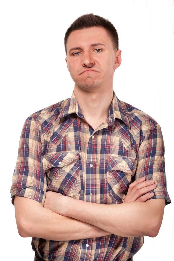 一件格子花呢上衣的人有滑稽的面孔表示的 免版税库存照片