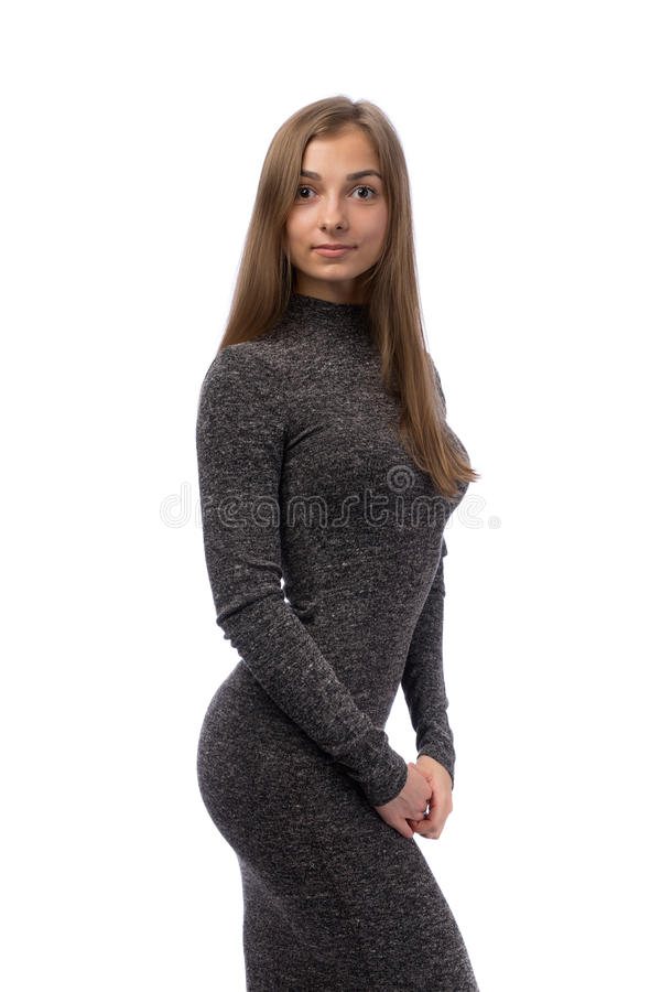 一件灰色礼服的俏丽的女孩在演播室 图库摄影