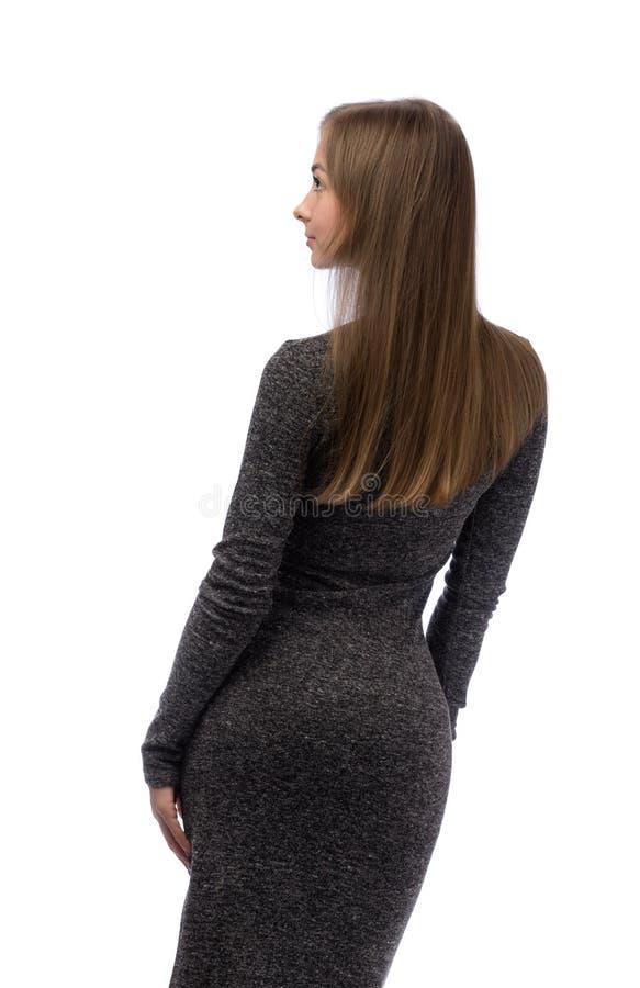 一件灰色礼服的女孩从后面 库存图片
