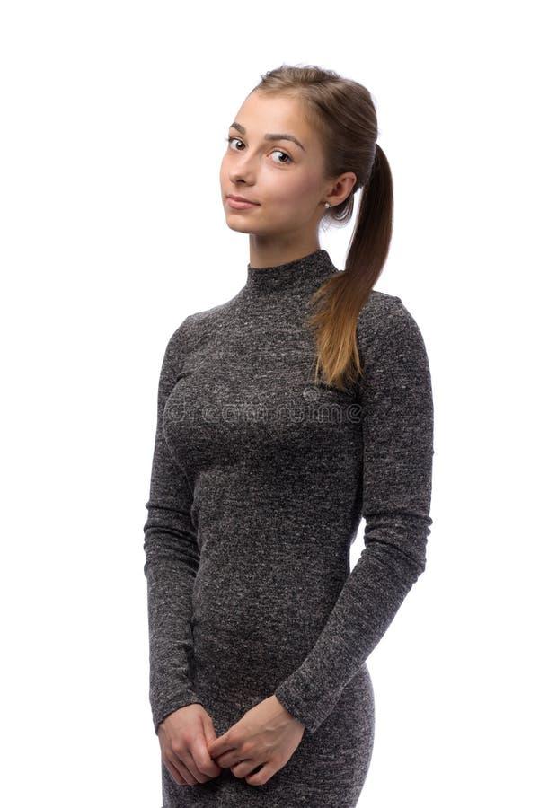 一件灰色礼服的女孩 库存图片