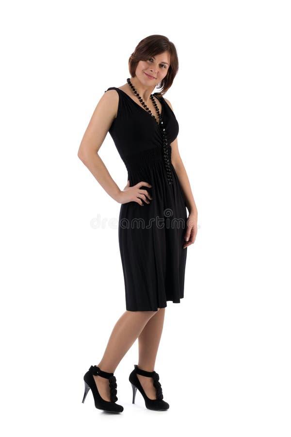 一件黑礼服的女孩在白色背景 免版税库存照片