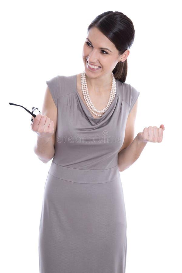 一件米黄礼服的可爱的愉快的年轻女商人 免版税库存照片