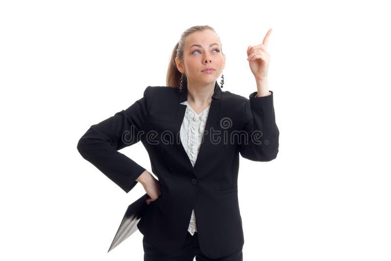 一年轻精力充沛事务白肤金发在一套黑衣服显示您的手指  库存照片