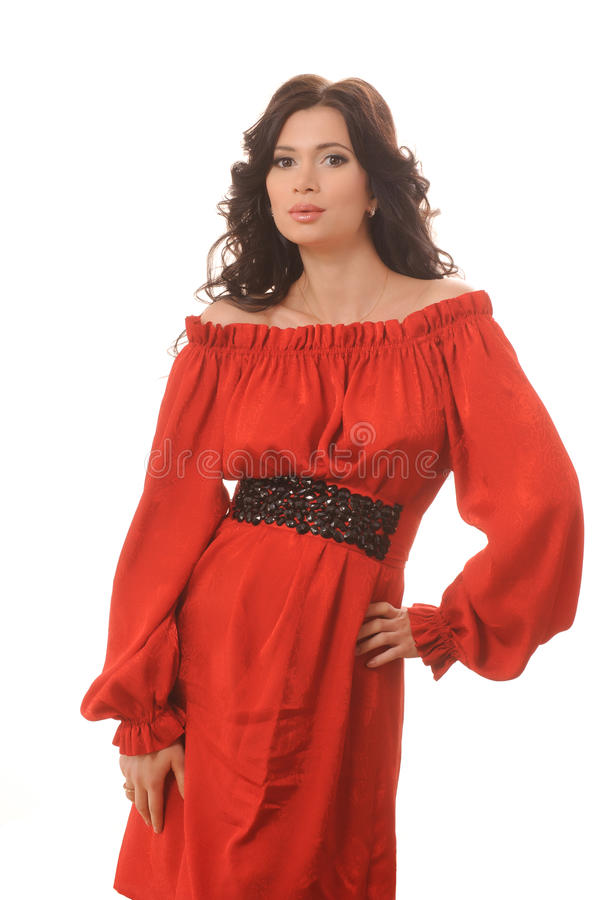 一件红色礼服的美丽的女孩在白色背景。 库存照片