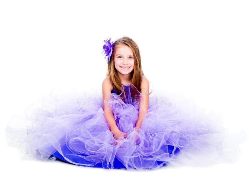 一件美丽的紫色礼服的小女孩 库存图片