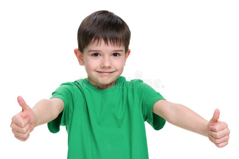 一件绿色衬衣的年轻男孩 库存照片
