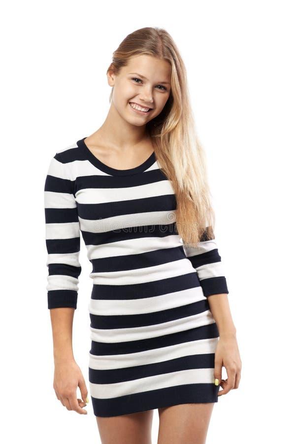 一件镶边毛线衣的女孩 免版税库存照片