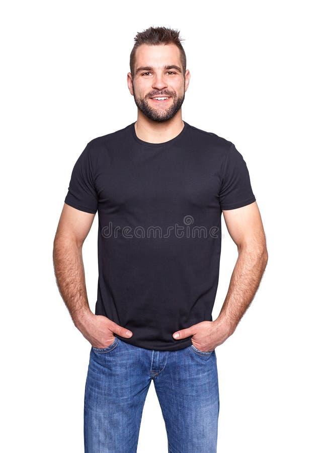 一件黑T恤杉的年轻英俊的人 库存照片