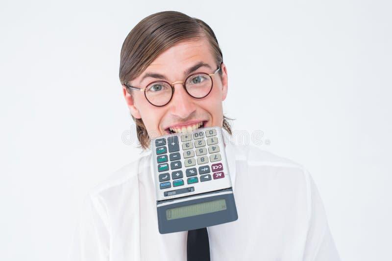 万人迷微笑的商人尖酸的计算器 免版税库存照片