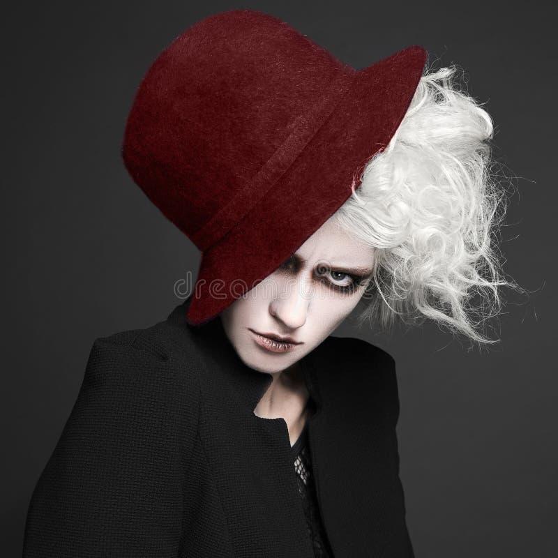 万圣夜帽子的构成妇女 免版税库存图片