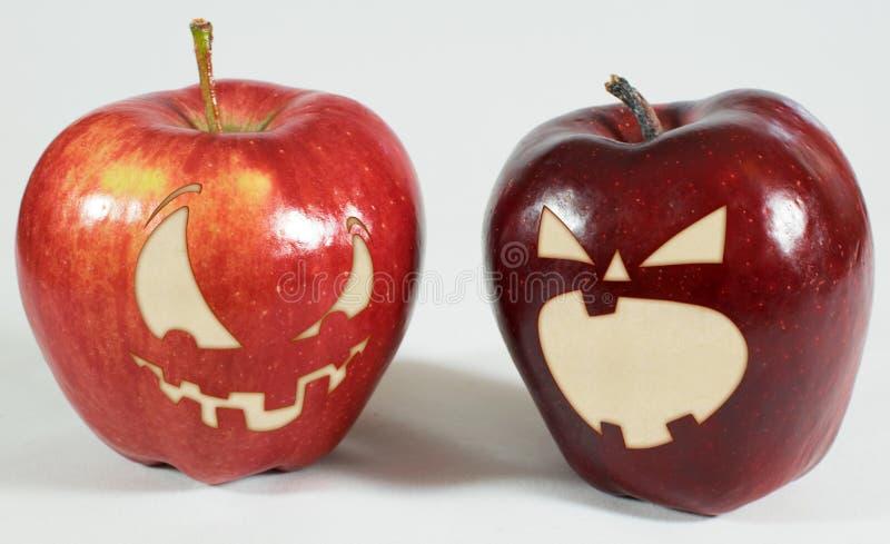 万圣夜-与面孔的苹果 免版税图库摄影