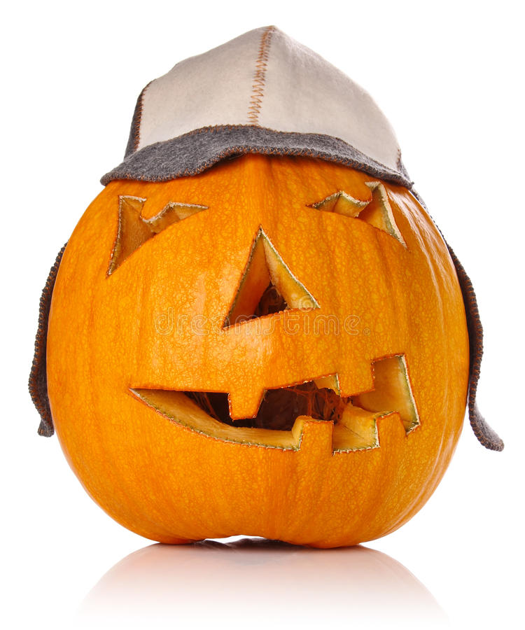 万圣夜Pumpkin.Scary温暖的盖帽的杰克O Lantern 库存照片