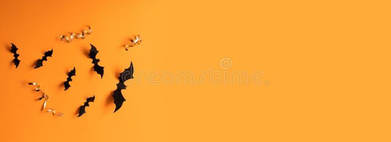 万圣节横幅与黑色,但是在橙色背景,顶视图 免版税库存图片