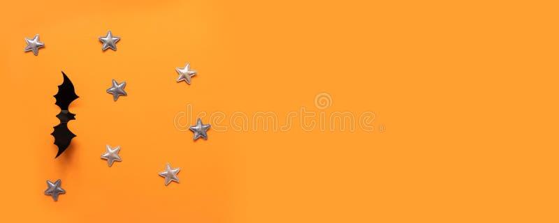 万圣节横幅与黑色,但是在橙色背景,顶视图 免版税库存照片