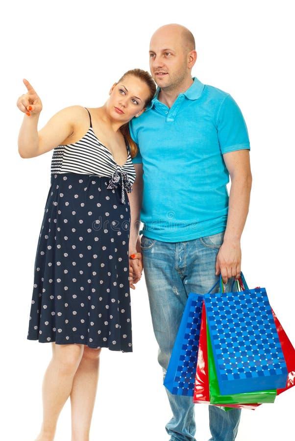 丈夫怀孕的购物妇女 免版税库存照片