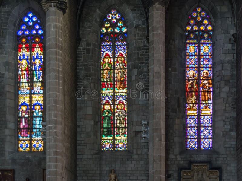 三个五颜六色的彩色玻璃窗在教会里 免版税图库摄影