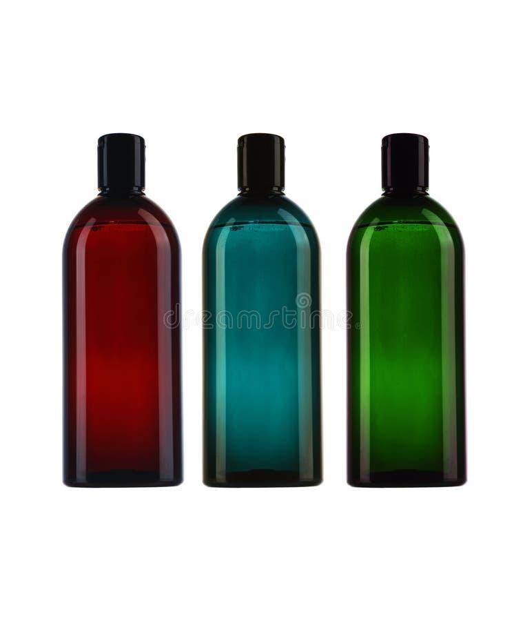 三个五颜六色的瓶 免版税库存图片