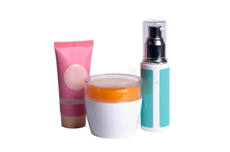 三个多彩多姿的化妆容器 免版税库存照片