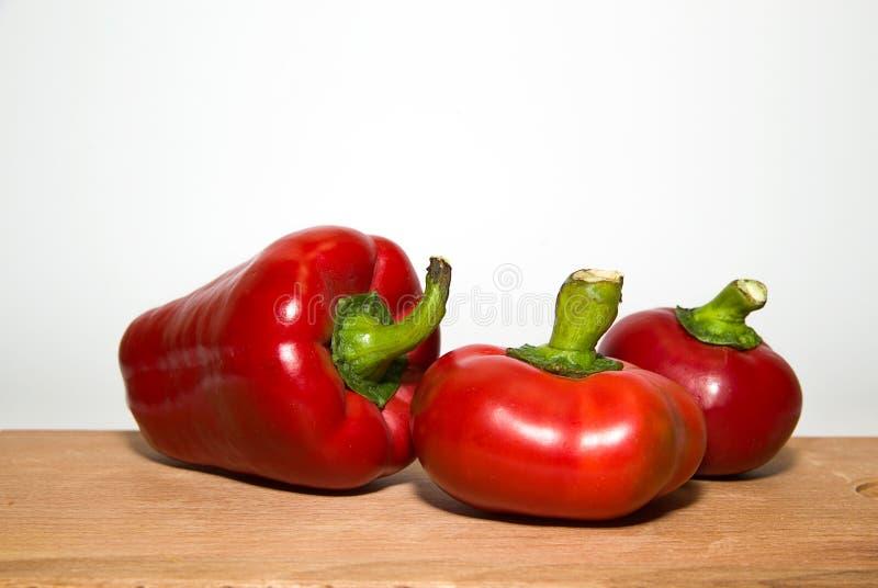 三个成熟红辣椒在白色 图库摄影