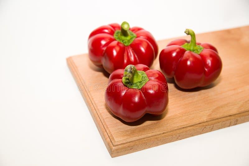 三个成熟红辣椒在白色 库存图片