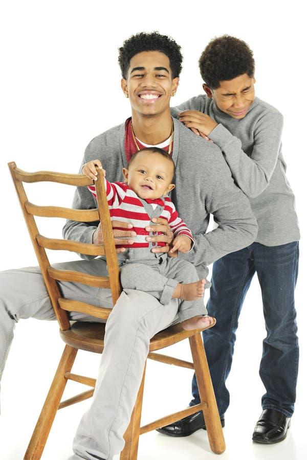 三个笑的兄弟 库存照片