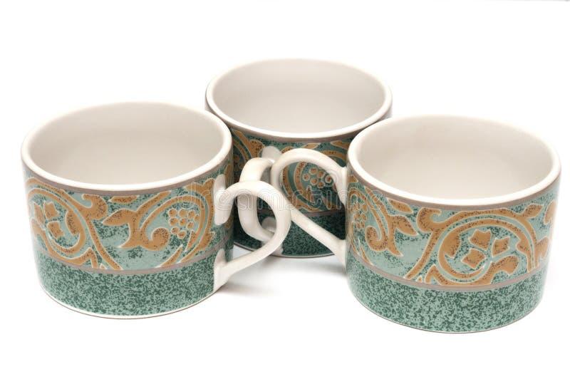 三个绿色打印的茶杯 免版税库存照片