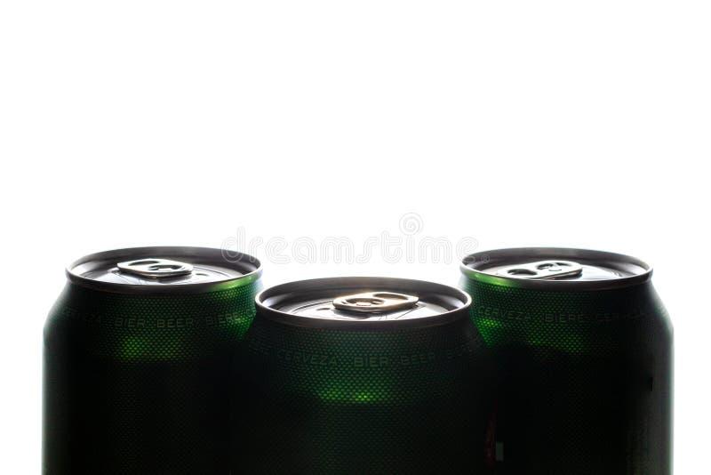 三个绿色罐头啤酒 免版税库存图片