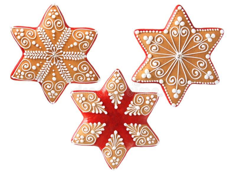 三个美丽的圣诞节曲奇饼 免版税库存照片