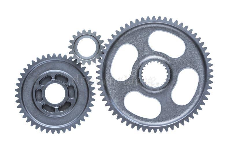 三个连接的钢嵌齿轮轮子 免版税图库摄影