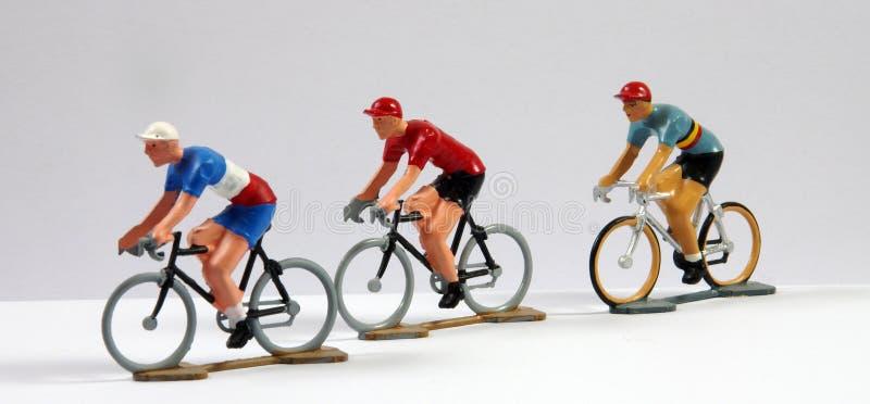 三个金属式样骑自行车者 库存图片