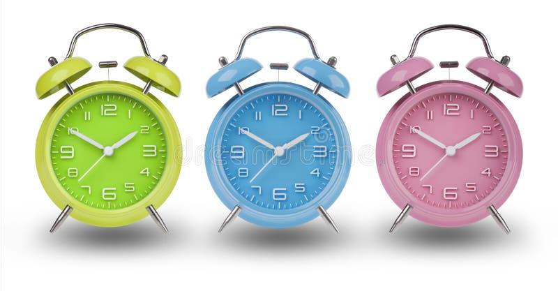 三个闹钟用在10和2的手 库存图片
