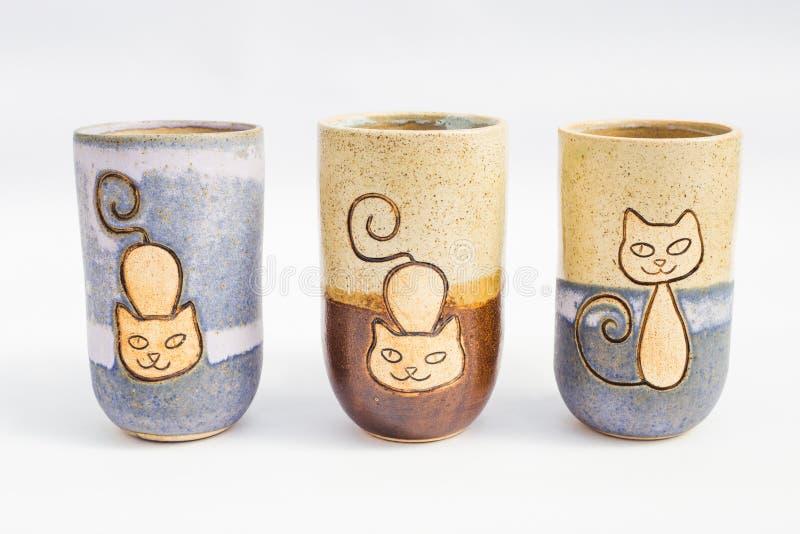 三个陶瓷石水罐有白色背景 库存照片