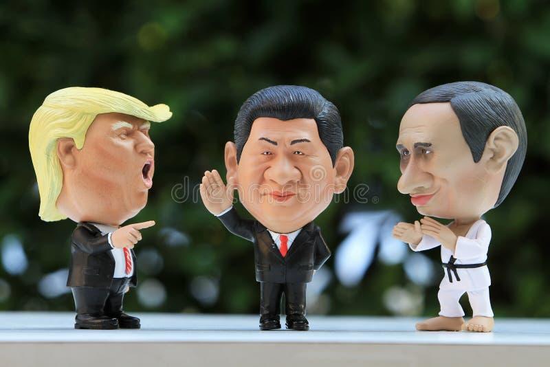 三个领导人式样形象接近的射击  库存图片