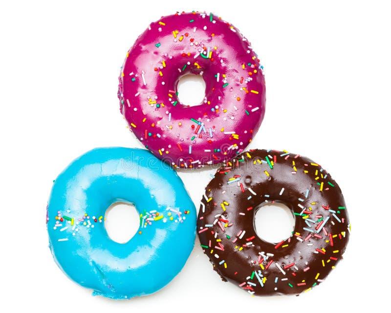 三个颜色油炸圈饼 免版税库存照片