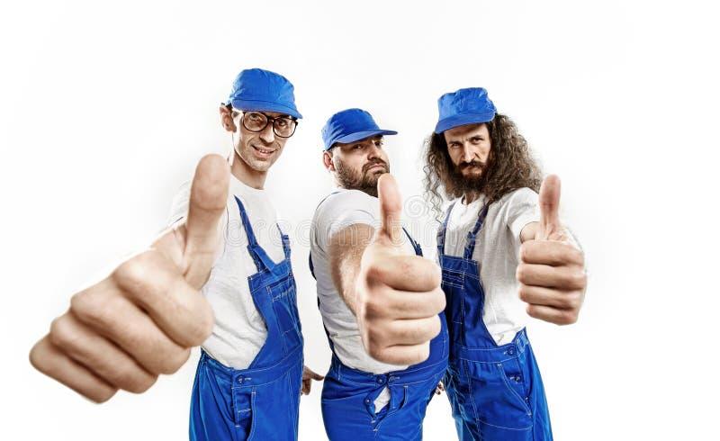 三位勇敢的工匠做 库存图片