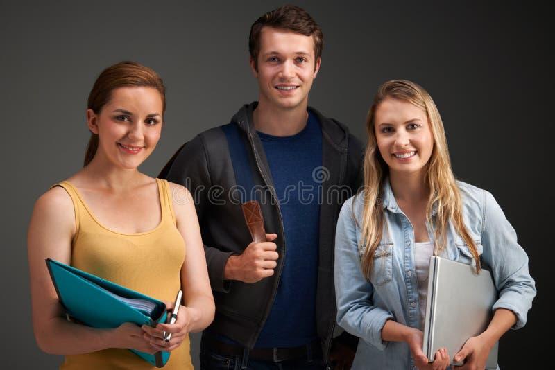 三位大学生演播室画象  免版税图库摄影