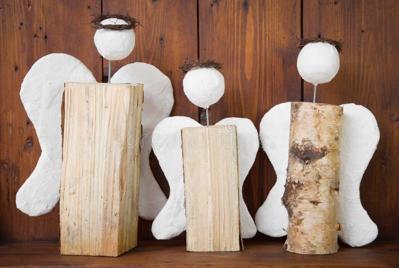 三天使手工制造圣诞节的木头 库存照片