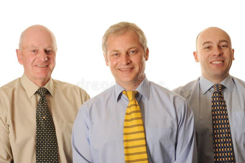 三愉快的生意人 免版税库存照片