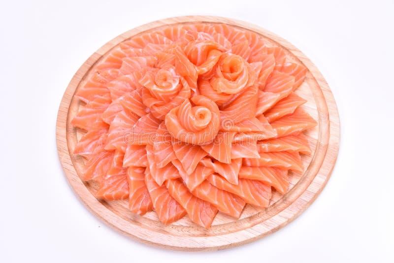 三文鱼在木板材滑 免版税库存照片