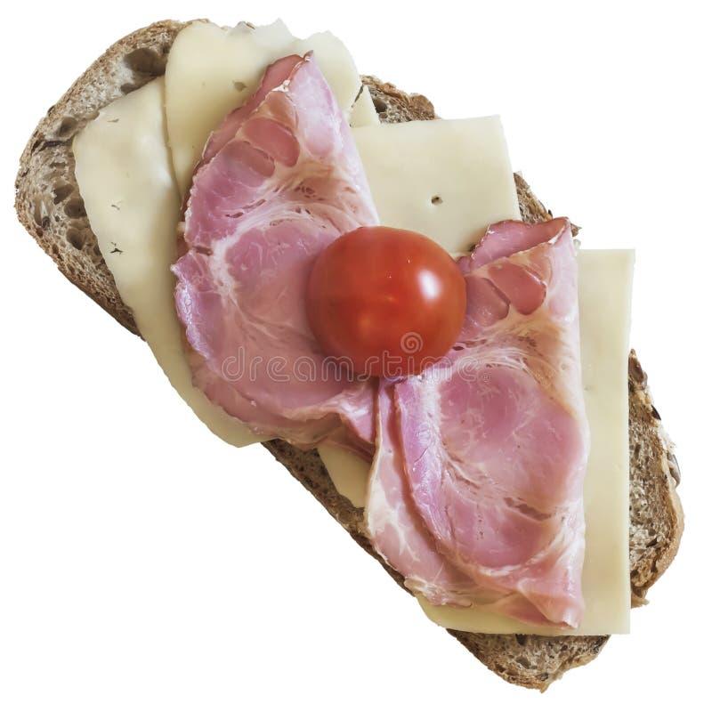 三明治用猪肉火腿被隔绝的伊顿干酪乳酪和西红柿 免版税库存照片