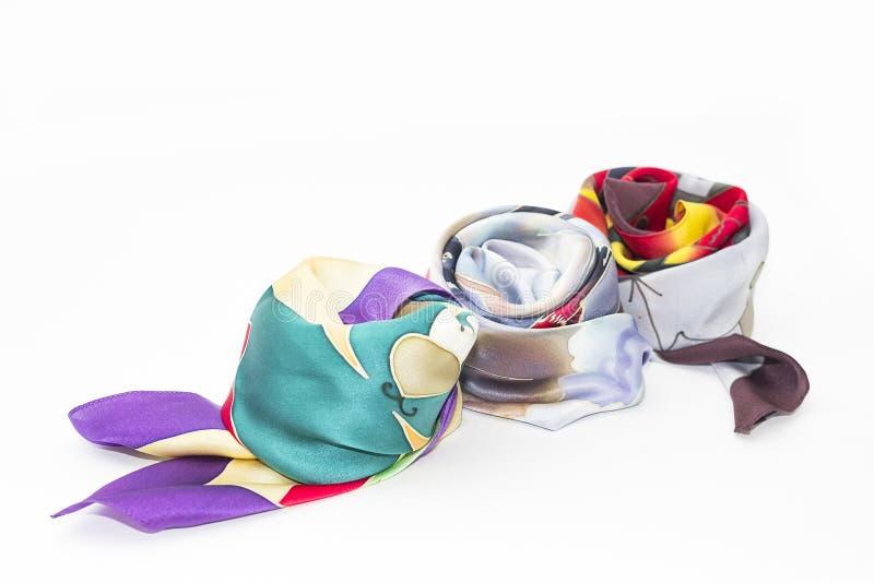 三条五颜六色的丝绸妇女的围巾 免版税图库摄影