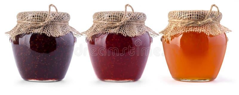 三瓶子果酱和蜂蜜 免版税库存照片