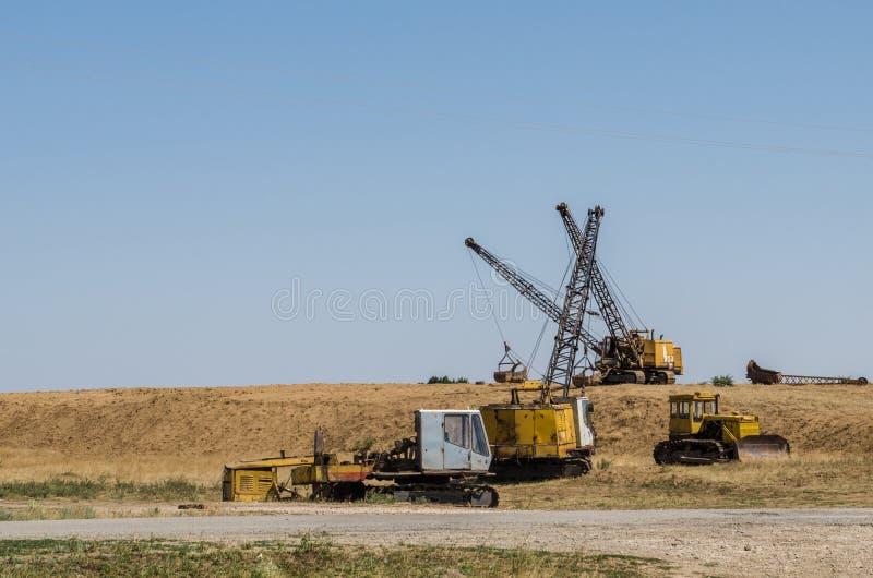 三种挖掘机牵引索一推土机和一折除了挖掘机 库存图片