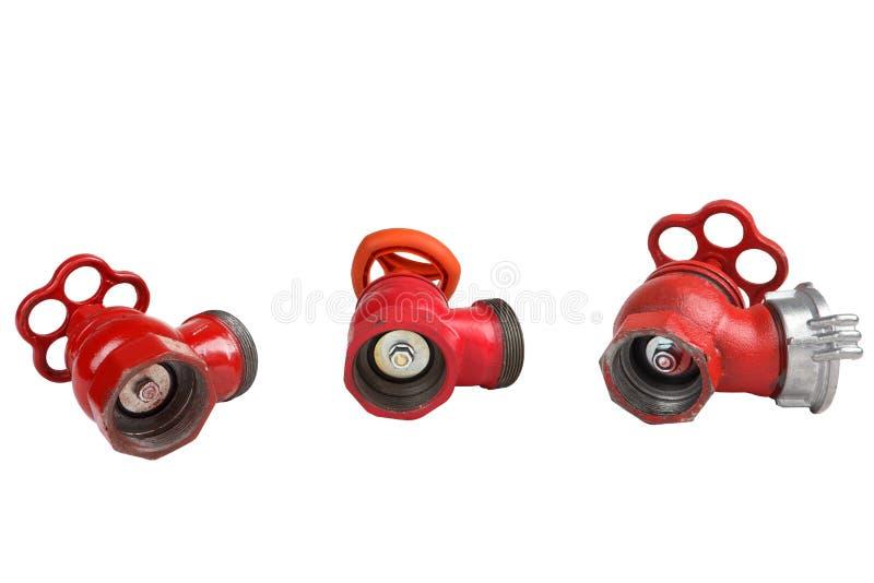 三红色生铁消防龙头阀门,在白色背景 库存图片