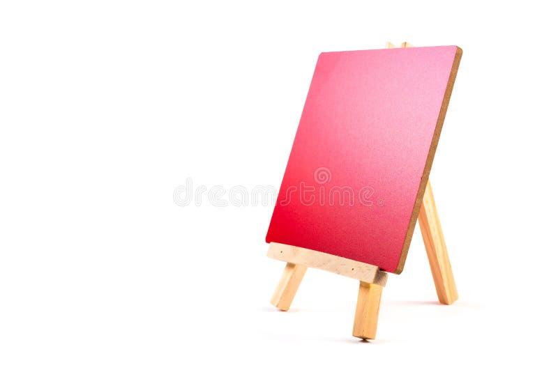 三脚架画架的红色委员会 免版税库存图片