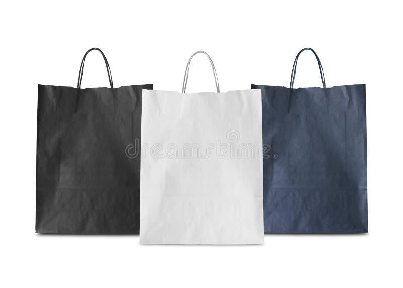 三被隔绝的白纸袋子(白色,黑,蓝色) 免版税库存照片